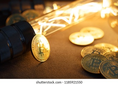 BTC among avid bulbs. The light flashes, an electrical short circuit. Closeup, Shallow depth of fields.