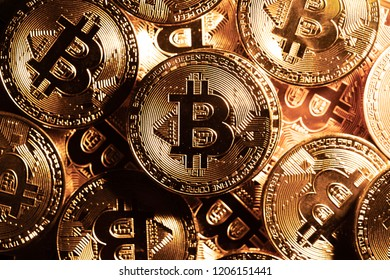 BTC, Bit Coin. Macro shot of top view pile of many Gold Bitcoin coins. Cryptocurrency trading concept.