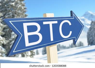 BTC (BITCOIN) arrow against snowy mountains