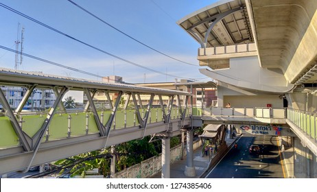 BTS Pak Nam Station taken in the evening There is a floating bridge connecting from the station down to the road below the BTS station. Photographed in the evening on 13 December 2018 in Samut Prakan