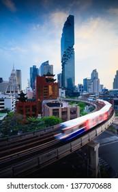 BTS skytrain and Mahanakhon building in background at silom road Bangkok business district, Bangkok Thailand