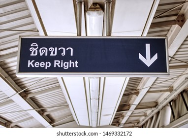 BTS Station, Bangkok, Thailand - 16 April 2019 - Keep right sign at sky train station. Way finding signs at BTS sky train, major city's transport, are important for commuter's safety and convenience.