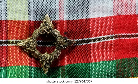 Buang Naka Bas on Thai north eastern  style cloth with space for write wording, Thai Naka loop amulet, metal amulet for praying and believe of luck, safety, wealthy and protecting dangerous evil