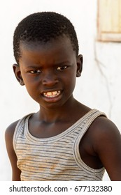 BUBAQUE, GUINEA BISSAU - MAY 5, 2017: Unidentified local little boy looks ahead in a village of the Bubaque island. People in G.-Bissau still suffer of poverty