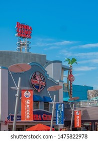 Bubba Gump Shrimp Co. tall sign standing on top of building at universal studios entrance with blue skies at Universal Studios Orlando Florida United States on March 24, 2019