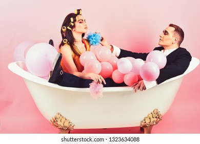 Bubble bath day. Couple in bath tub. Couple of mime man and sexy woman enjoy bathing. Beauty routine and personal hygiene. Hair grooming routine. Bathing hygiene habits. The same routine every day.