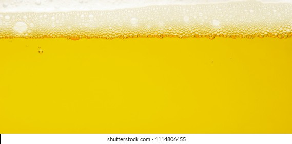 bubble beer close up, abstract background, yellow
