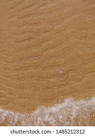Bubble in Bordeira beach sand.