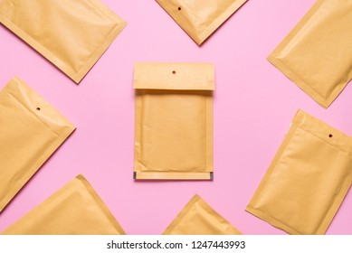 Lot of bubble envelopes on pink background