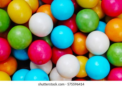 Bubble gum chewing gum texture. Rainbow multicolored gumballs chewing gums as background. Round sugar coated candy dragee bubblegum texture. Food photography. Colorful bubblegums wallpaper. Sweets.