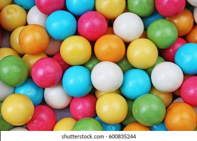 Bubble gum chewing gum texture. Rainbow multicolored bubblegum balls chewing gums as background. Round sugar coated retro bubblegum texture.  Colorful bubblegums wallpaper.