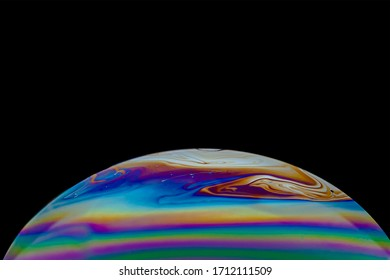 Bubble soap macro photography with beauty of colorful  rainbow pattern, shallow depth of field and dark background