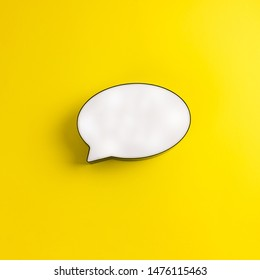 Bubble speech on a sunny yellow background. Place for text, lettering or product. View from above, Copy space. Flatlay