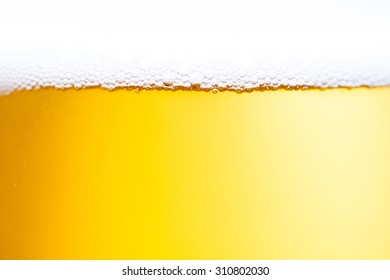 Bubbles of beer froth in glass
