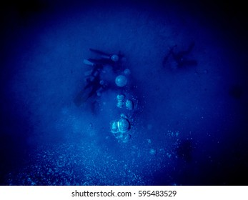 Bubbles From Divers In The Deep Ocean