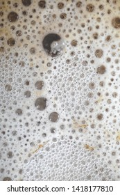 Bubbles foam brown coffee or beer, super macro close-up shot 5x