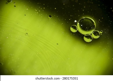 Bubbles in water with green background