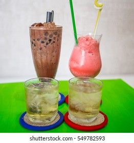 Bubbletea with colorful candy and jelly sweet close up. Homemade chocolate or strawberry cocktail, cocoa, smoothies, milk shake.