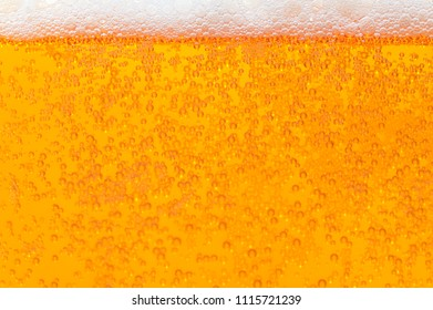 Bubbling beer in the glass as background