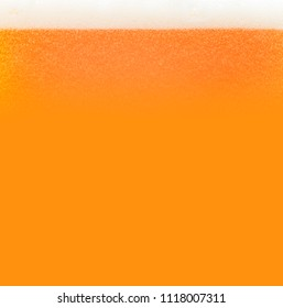 Bubbling beer in the glss, background or texture