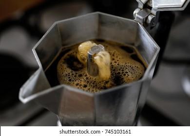 Bubbling espresso coffee in a stovetop moka express.