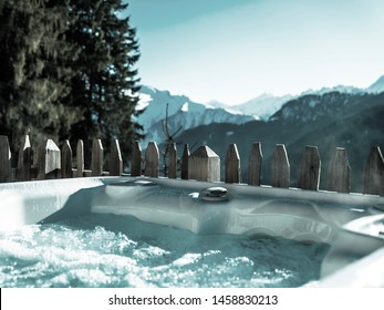 A bubbling hot tub perched in the heart of the Austrian alps. A true dream location.