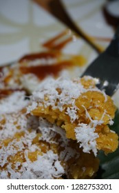 Bubur Madura, an Indonesian dessert consist of sticky rice, biji salak, bubur sumsum, mutiara, served with coconut gravy (thick) and brown sugar.