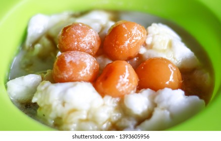 Bubur sum sum on white background. Bubur sum sum is an Indonesian dessert made by cooking rice flour in coconut milk and served with palm sugar syrup.