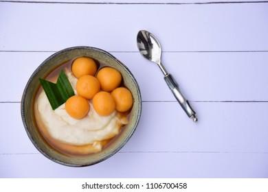 Bubur Sumsum Biji Salak, Indonesian rice flour porridge with sweet potato glutinous rice balls, served with palm sugar sauce. Popular food during Ramadan