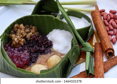 Bubur Sumsum. Javanese dessert porridge of rice flour, coconut milk with palm sugar syrup. Served with black sticky rice, green beans, sticky brown rice, and pearl porridge. Packed with banana leaf