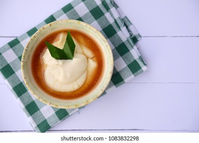 Bubur sumsum, rice porridge with palm sugar and pandan leaf