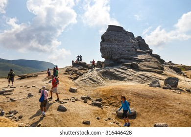 Bucegi Mountains, Romania July 09, 2015: Unidentified group of bikers climbs the hill in Bucegi Mountains in Romania on July 09, 2015.