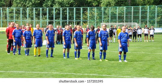 BUCHA, UKRAINE - 23 AUGUST 2013: The amateur football team of Ukraine listens the hymn before the competition devoted to national Day of Ukrainian flag on August 23, 2013 in Bucha, Ukraine.