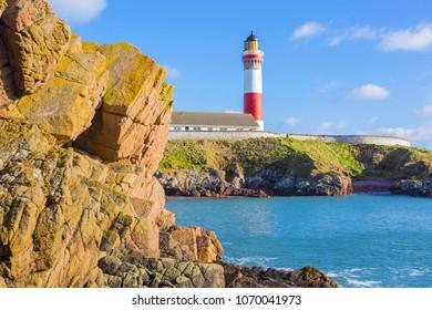 Buchan Ness lighthouse, built in 1825, on Moray Firth Coast; Aberdeenshire, Scotland