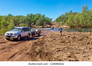 Buchanan Highway, Australia - July 10, 2010: 4WD vehicles cross the Victoria River in outback Northern Territory in Austrtalia.