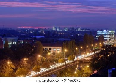 Bucharest and Dimbovita river at night.