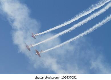 "BUCHAREST - JULY 21: ""Iacarii Acrobati and Jurgis Kairys"" perform at Bucharest International Air Show & General Aviation Exhibition (BIAS 2012) on July 21, 2012 in Bucharest, Romania"