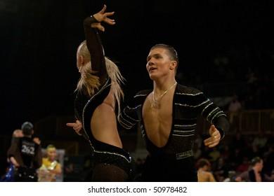 BUCHAREST - MARCH 14: Yury Simachev - Anastasia Klokotova RUSSIA, dance couple at IDSF Dance Masters on March 14, 2010 in Bucharest, Romania.