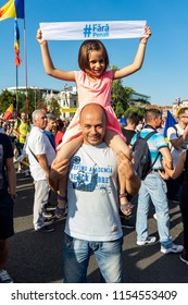 Bucharest, Romania - 10 August 2018: Father and daughter protesting against the way Romania is governed by the ruling Social Democrat-PSD
