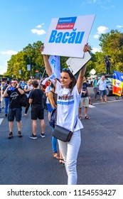 Bucharest, Romania - 10 August 2018: Young woman looking for people to sighn a iniative to change the contitution during Diaspora protest against the way Romania is governed by Social Democrats