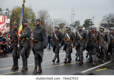 BUCHAREST, ROMANIA - 1st of December, 2017: Romanian soldiers carry flags as they participate at repetition for Romanian National Day parade, that takes place on the 1st of December