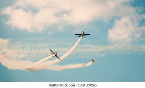 BUCHAREST, ROMANIA, 2018: Acrobatic planes at Bucharest International Air Show (BIAS) with blue sky background