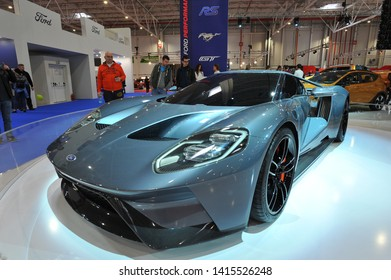 Bucharest, Romania - 2018/03/31: Visitors of 2018 Salonul International de automotile Bucharest beside the impressive Ford GT supercar on the Ford Motor Company Performance exposition