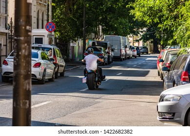 Bucharest, Romania - 2019. Man on a motercycle on a one way street.