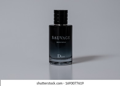 Bucharest / Romania - 4 04 2020: Bottle of the very popular Dior Sauvage Eau de parfum isolated on white with a light reflexion and shadow