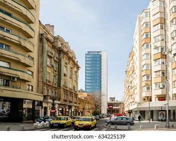 BUCHAREST, ROMANIA - APR 1, 2016: Large view over Bucharest street - Strada General H. M. Berthelot on a sunny day with typical Romanian contrast architecture