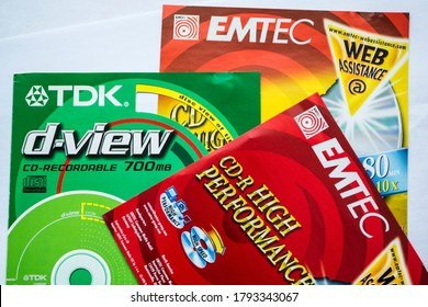 BUCHAREST, ROMANIA - APRIL 02, 2020: EMTEC and TDK paper labels for cd, dvd, compact disc.