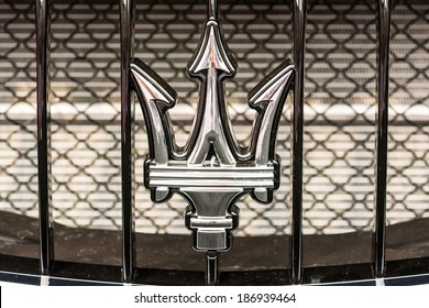 BUCHAREST, ROMANIA - APRIL 04, 2014: Maserati Sign Close Up. Maserati is an Italian luxury car manufacturer established in 1914 in Bologna and its emblem is a trident.