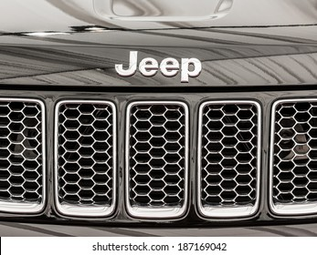 BUCHAREST, ROMANIA - APRIL 04, 2014: Jeep Grand Cherokee Sign Close Up. The Jeep Grand Cherokee has always used a unibody chassis and is an SUV produced by the Jeep division of Chrysler.