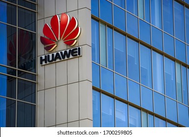 Bucharest, Romania -  April 08, 2020: A logo of Huawei, Chinese telecommunications equipment company, is displayed on the top of a building, in Bucharest, Romania.